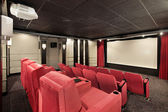 Home theater with red chairs — Stock Photo