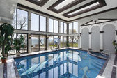 Indoor swimming pool with lake view — Stock Photo