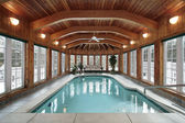 Swimming pool with wood ceiling beams — Stock Photo