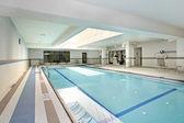Swimming pool in condominium building — Stock Photo