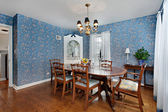 Dining room with blue wallpaper — Stock Photo