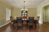 Dining room with gold walls — Stock Photo