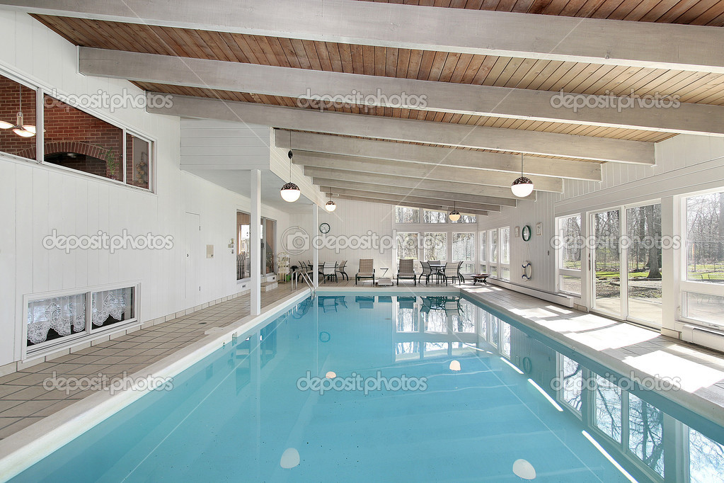 Swimming pool in luxury home with white beams  Stock Photo #8689049