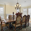 Foto Stock: Dining room with cream colored walls