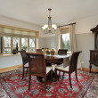 Dining room with wood trim windows — Stok fotoğraf