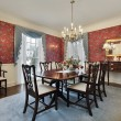 Dining room with red floral wallpaper — Foto Stock