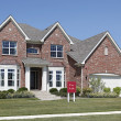 """Brick home with """"For Sale"""" sign — Stock Photo"""