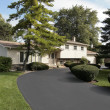 Stock Photo: Home in suburbs with circular driveway