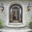 Arched stone entry to luxury home — Stock Photo #8692383