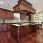 Kitchen with island stove — Stock Photo #8694652
