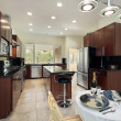 Stock Photo: Kitchen with dark wood cabinetry