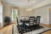 Dining room with black table — Stock Photo