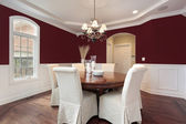 Dining room with red walls — Stock Photo