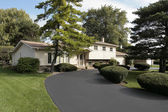 Home in suburbs with circular driveway — Stock Photo