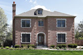 Brick home with arched entry — Stock Photo