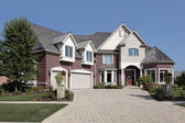 Luxury brick home with stone pillars — Stock Photo