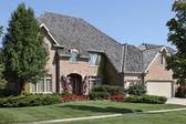 Brick home in suburbs — Stock Photo