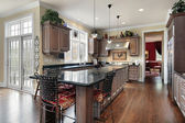 Elegant kitchen with black marble island — Stock Photo
