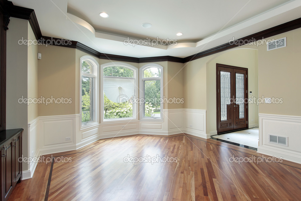 Dining room in luxury home with foyer view  Stock Photo #8690965
