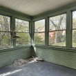 Stock Photo: Green porch in old abandoned home