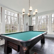 Pool table in sunroom - Stock Photo