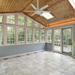 Sunroom with wall of windows - Stock Photo