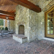 Brick patio with stone fireplace — Stock Photo