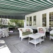 Stock Photo: Patio with green awning