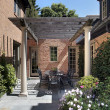 Stock Photo: Bluestone patio and wood pergola