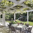Patio with white wood beams — Stock Photo