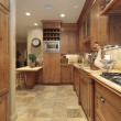 Country kitchen with oak cabinetry — Stock Photo #8701460