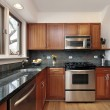 Stock Photo: Kitchen with cherry wood cabinetry
