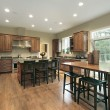 Luxury kitchen with wood cabinets — Stock Photo