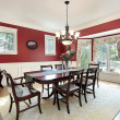 Dining room with red walls — Stockfoto