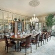 Stock Photo: Formal dining room with wall mirrors