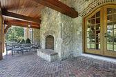 Brick patio with stone fireplace — Stock Photo