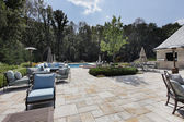 Large stone patio with swimming pool — Stock Photo