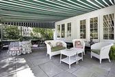 Patio with green awning — Stock Photo