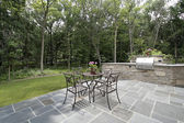 Bluestone patio and stone grill — Stock Photo