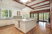 Kitchen with ceiling wood beams — Stock Photo