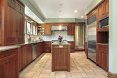 Kitchen with wood cabinetry — Stock Photo