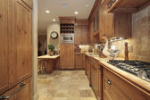 Country kitchen with oak cabinetry — Stockfoto