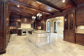 Upscale kitchen with wood ceilings — Stock Photo