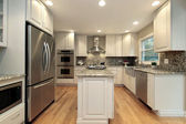 Kitchen with light colored cabinetry — Stock Photo