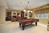 Pool table and family room — Stock Photo