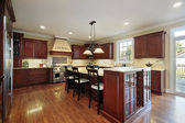 Kitchen with cherry wood cabinetry — Стоковое фото