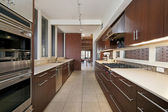 Kitchen with dark wood cabinetry — Stock Photo