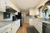 White kitchen in suburban home — Stock Photo