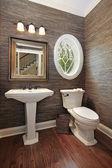 Powder room in luxury home — Stock Photo