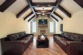 Family room with wood ceiling beams — Stock Photo